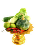 Vegetables mix on golden tray. On white background Royalty Free Stock Image