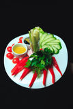 Vegetables mix on the white plate. Vegetables mix of tomato, cucumber, salad, olives and pepper Stock Images