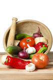 Vegetables in mortar kitchen Stock Photos