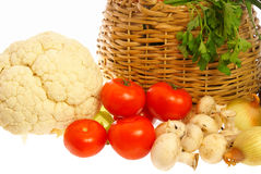 Vegetables and mushrooms. Vegetables, mushrooms and basket on white background Stock Images