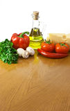 Vegetables, mushrooms, cheese and oil on table Royalty Free Stock Photo