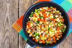 Vegetables with mushrooms, cooked in frying pan Stock Photo