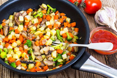 Vegetables with mushrooms, cooked in frying pan Stock Image