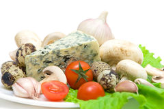 Vegetables, mushrooms, quail eggs and cheese close up Stock Photography