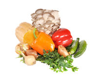 Vegetables with mushrooms  on a table. Vegetables with mushrooms lay on a table Royalty Free Stock Photography
