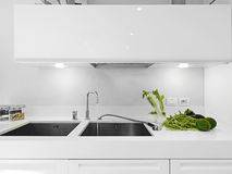 Vegetables near the faucet on the sink Stock Photos