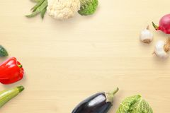 Vegetables neatly arranged on a kitchen table with free space for adding text Stock Photography