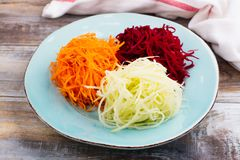 Vegetables noodles. Homemade raw fresh zucchini, carrot and beet root pasta. Assortment of vegetables noodles. Homemade raw fresh zucchini, carrot and beet root Stock Image