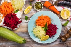Vegetables noodles. Homemade raw fresh zucchini, carrot and beet root pasta Stock Photo