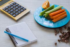 Vegetables and nuts on the scales. Calorie counting Stock Photos