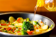 Vegetables and oil Royalty Free Stock Images