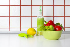 Vegetables, oil and scraper on kitchen counter background Royalty Free Stock Photos