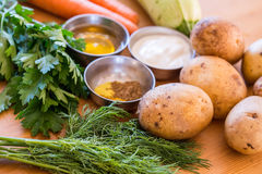 Vegetables, oil, sour cream and spices Royalty Free Stock Photography