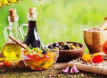 Vegetables with oil on wooden table outdoor Royalty Free Stock Photos