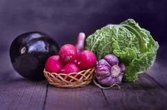 Vegetables on the old boards and a blurred background. Stock Image