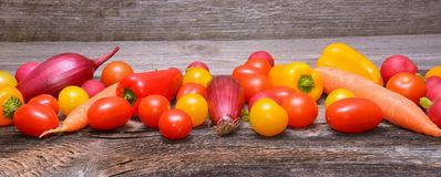 Vegetables on old wooden background Royalty Free Stock Photos