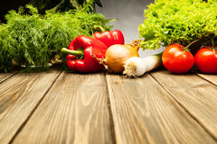 Vegetables on old wooden table Stock Image