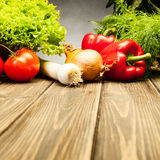 Vegetables on old wooden table Royalty Free Stock Images
