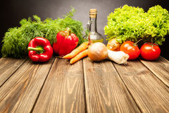 Vegetables on old wooden table Royalty Free Stock Photography