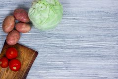 Vegetables on an old wooden table, ingredients, top view, copy space Stock Images