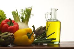 Vegetables and olive oil Royalty Free Stock Photos