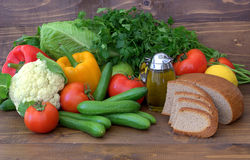 Vegetables, olive oil and bread.  Healthy eating. meatless products. Stock Image