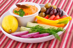 Vegetables, olives, cheese sauce in plate Stock Photo