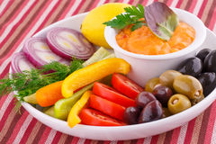 Vegetables, olives, lemon and cheese sauce Stock Image