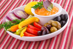 Vegetables, olives, lemon and cheese sauce Stock Photography