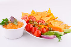 Vegetables, olives, nachos and cheese sause Royalty Free Stock Photos
