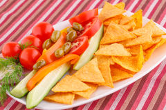 Vegetables, olives, nachos in plate Royalty Free Stock Image