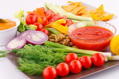 Vegetables, olives, nachos, red and cheese sause. Image Stock Photos
