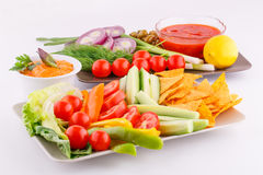 Vegetables, olives, nachos, red and cheese sause Stock Photo