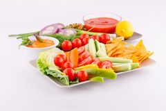 Vegetables, olives, nachos, red and cheese sause Stock Photos