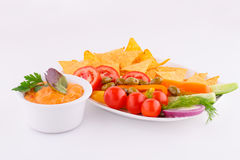 Vegetables, olives, nachos, red and cheese sause Stock Images