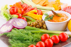 Vegetables, olives, nachos, red and cheese sause Royalty Free Stock Photography