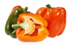 Vegetables of orange and green pepper isolated on white background Royalty Free Stock Photo