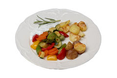 Vegetables and oven potatoes. Plate with vegetables and oven potatoes Royalty Free Stock Photos