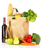 Vegetables in paper bag and wine bottles isolated Royalty Free Stock Photos