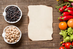 Vegetables, paper and chickpea Stock Photography