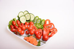 Vegetables. Paprika, cherry tomato, carrot, sliced cucumber and lettuce Stock Image