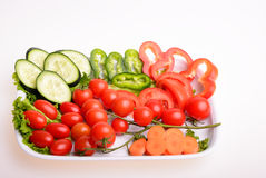 Vegetables. Paprika, cherry tomato, carrot, sliced cucumber and lettuce Stock Photo