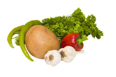 Vegetables and parsley. Potato, pepper and bunch of a parsley lay together isolated on white Royalty Free Stock Images