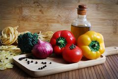 Vegetables and pasta. Beautiful shot of pasta with vegetables and oil Stock Photos