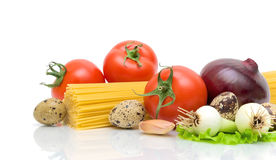 Vegetables, pasta, eggs on a white background Royalty Free Stock Image