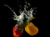 Vegetables - peppers dropped under water Stock Photos