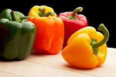 Vegetables - Peppers On Black Background Stock Photos