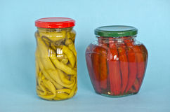 Vegetables peppers preserved in two glass jars Royalty Free Stock Photography