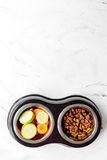 Vegetables and petfood on kitchen table background top view mock up stock image
