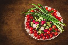 Bowl of vegetables on wooden background in top view Royalty Free Stock Photo